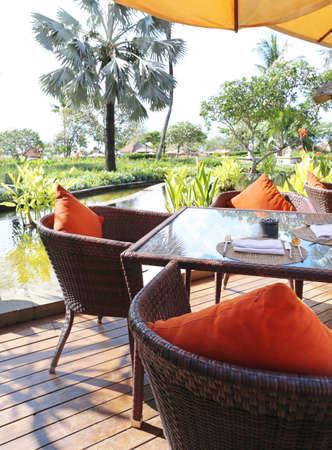 tropical garden: chair at summer terrace restaurant