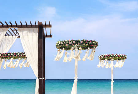 hotel resort: Wedding flower set up on the beach Stock Photo