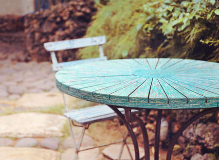 rustic: table at summer terrace restaurant. Selective focus , vintage filter Stock Photo