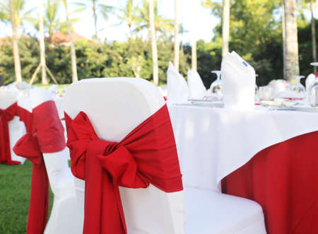bahamas celebration: Decorated wedding table on a green lawn Stock Photo