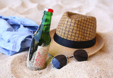 brazil beach swimsuit: Beer bottles, hat, sunglasses on the beach