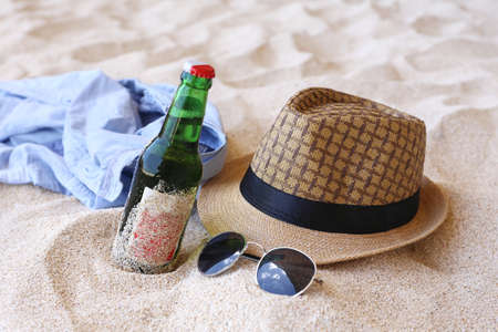 brazil beach swimsuit: hat and sunglasses on the beach Stock Photo