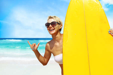 surfer girl on the beach Stock Photo