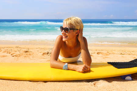 surfer girl on the beach Stock Photo