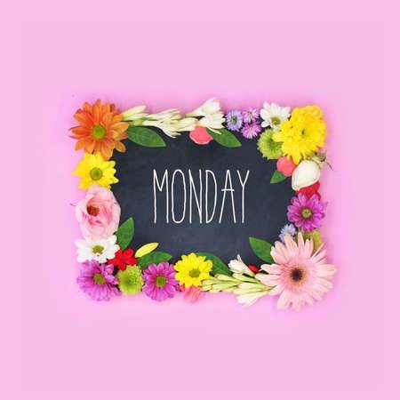Monday word on black board Imagens