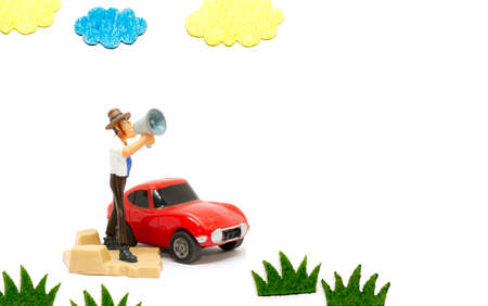 Cartoon doll standing shouting using megaphone, white background image Stock Photo