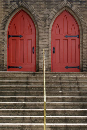 Stairs leading up to double church doors.               photo