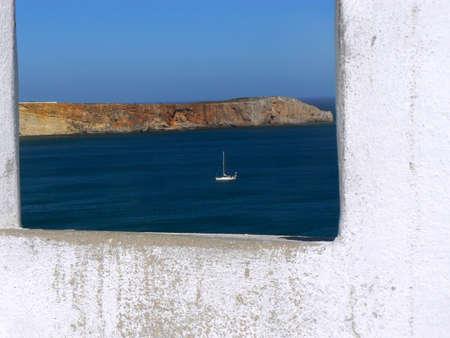 Sailboat throw the window - Sagres - Portugal photo