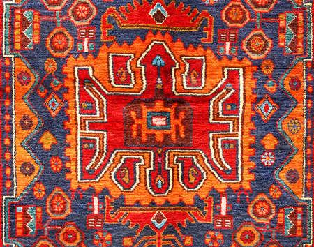ancient geometric: Beautiful ancient oriental colorful carpet with geometric motifs Stock Photo