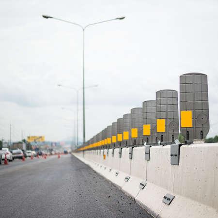 dangerous road: Empty hazard yellow warning signs along the dangerous road at night.