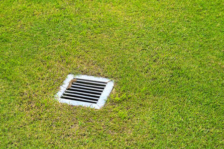 The sewer grate on the lawn - drainage for heavy rain 版權商用圖片 - 37938468