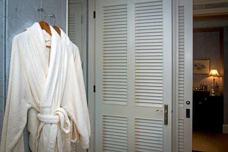 Close up of twins bathrobe in wardrobe background Stock Photo - 37938525