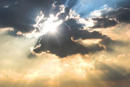 Rays of light shining through dark clouds 写真素材