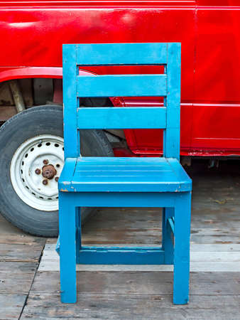 Old chair in blue photo