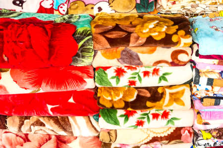 red carpet background: A stack of neatly folded colored blankets. Stock Photo