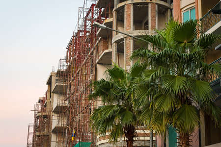 Construction of new buildings with red bricks.