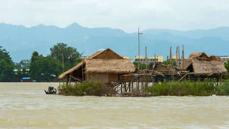 Traditional Wood Houses on Stilts at Inle Lake in Myanmar.