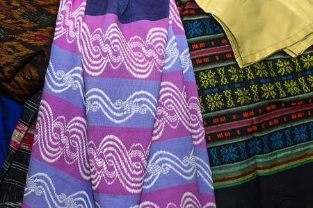 Colorful traditional longyi cloth and fabric sold in Bogyoke Aung San Market, Myanmar
