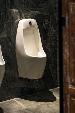 old urinals in mens bathroom.