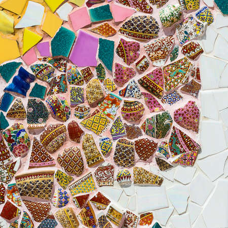 Colorful ceramic pattern background made from pebble and ceramic on the wall.