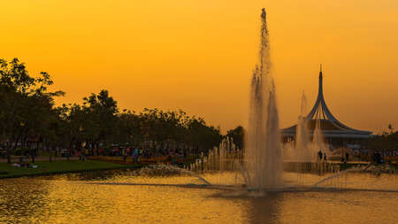 Beautiful sunset and fountain wate at Suan luang Rama 9 park, Bangkok, Thailand (Public Park)
