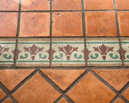 Antique mosaic pattern with terracotta bricks.