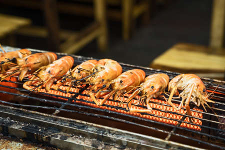 Grilled shrimp, street food at Thailand floating market. Stok Fotoğraf