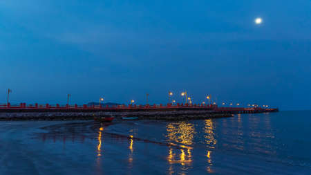 The red bridge and the people who exercise Walk to see the view at Prachuap Bay in the evening time in Thailand.