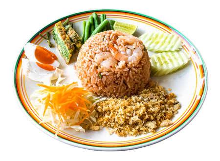 Thai food - Kao Cluk Ka Pi (Mixed Cooked Rice with Shrimp Paste Sauce) on white round dish