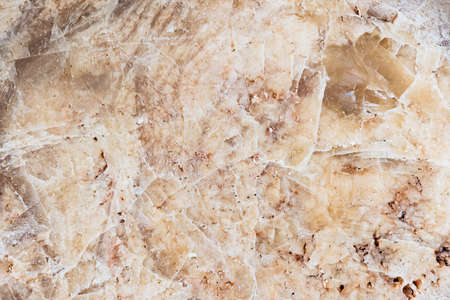 seamless background texture of natural raw stone brown granite