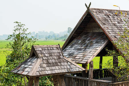 The wooden roof of an ancient house in northern Thailand
