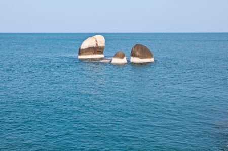 group of rocks in the sea photo