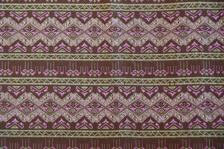 thailand silk: closeup pattern texture of general traditional thai style native handmade  fabric weave