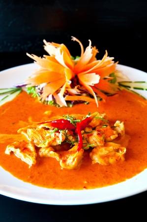 thai ethnicity: chicken red curry spicy thai food Stock Photo