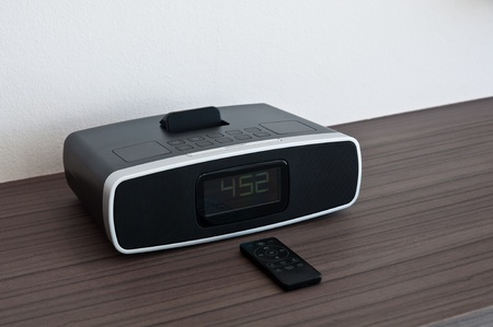 Modern digital electronic clock and radio with remote control photo