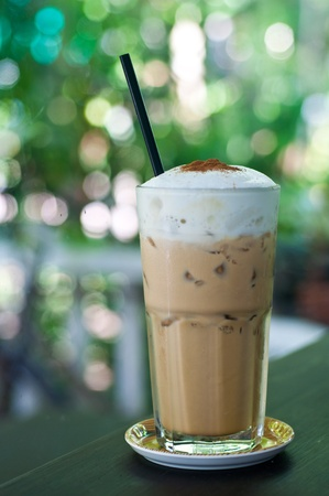 frappe: glass of ice coffee on table with bokeh background Stock Photo