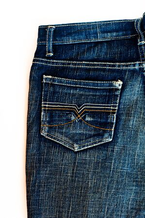 back pocket of blue jeans isolated on the white background photo