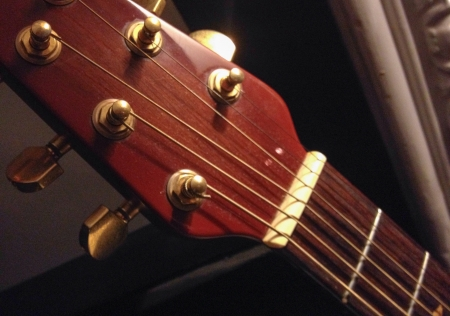 Closeup of a polished wood guitar headstock