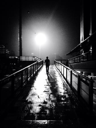 Silhouette of a man walking away