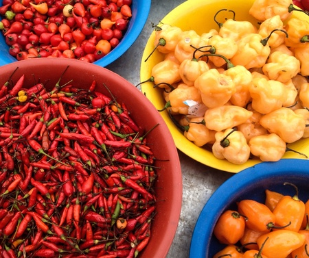 Peppers for sale in a colorful display Stock Photo