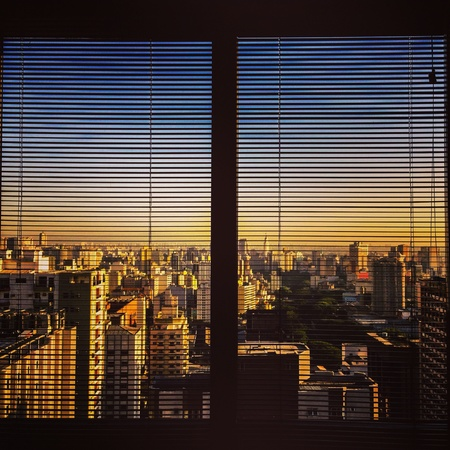 Cityscape seen through blinds Stock Photo