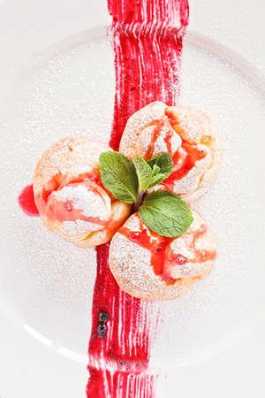 choux bun: Fruits profiterole, french dessert with mint