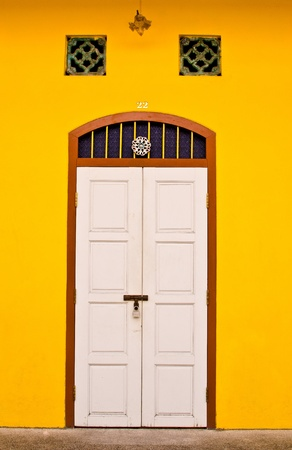 White door with yellow wall photo