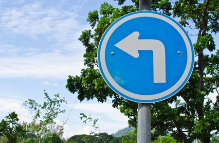 Traffic Sign Turn Left in the park Stock Photo