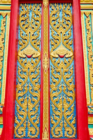 Golden and red Thai temple door sculpture  Stock Photo - 17304171
