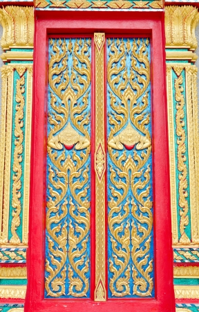 Golden and red Thai temple door sculpture  Stock Photo - 17304164