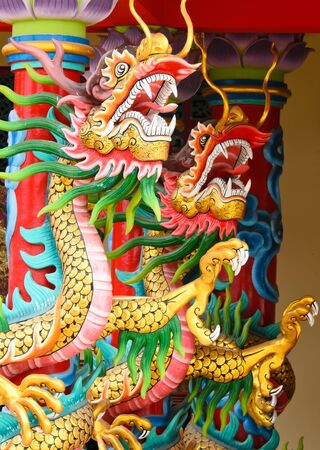 dragons wrapped around the pole in chinese temple Stock Photo