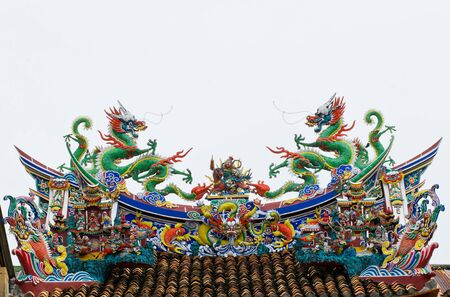 Twin statue of dragons on the roof with white background photo
