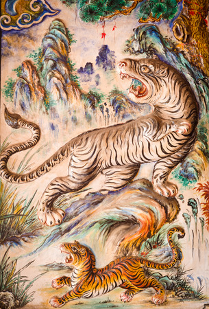 Ancient tigers design on wall background in chinese temple at Phuket Stock Photo - 22225353