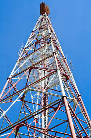 Telecommunication tower with blue sky photo